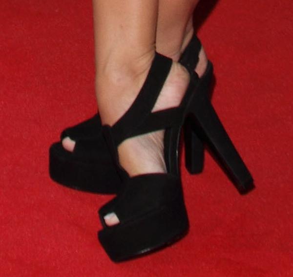 Caroline Flack wearing black shoes on the red carpet
