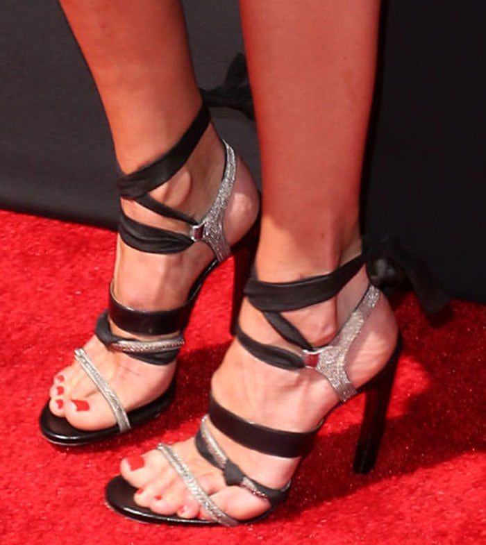Cat Deeley wearing black strappy sandals