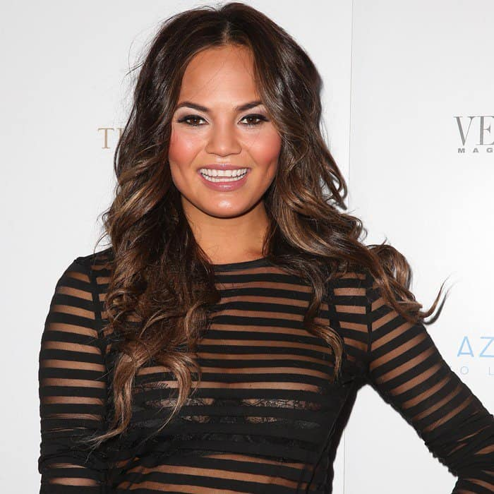 Chrissy Teigen wearing a shadow stripe long sleeve tee from Alexander Wang at Vegas Magazine's Summer Issue Party