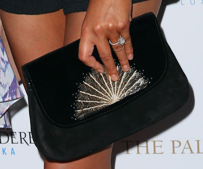 Chrissy carrying a Chloé 'The Éventail' suede clutch