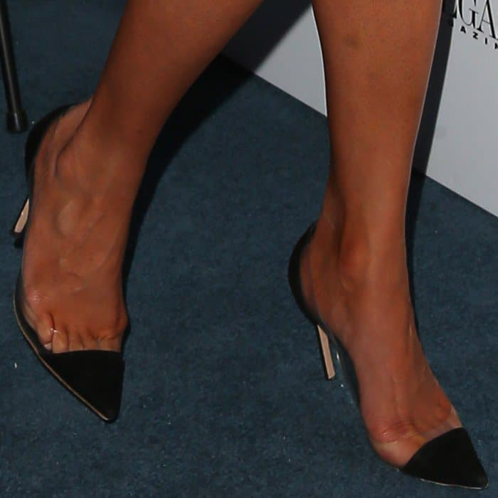 The model in clear cap-toe pumps