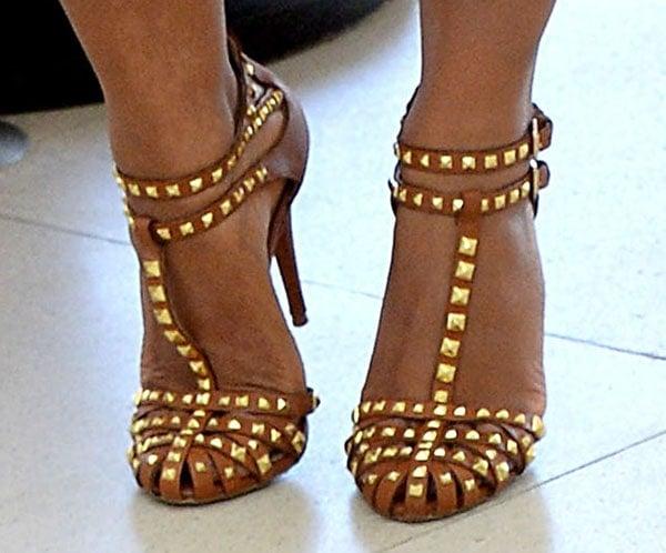 Christina Milian wearing studded cognac t-strap pumps