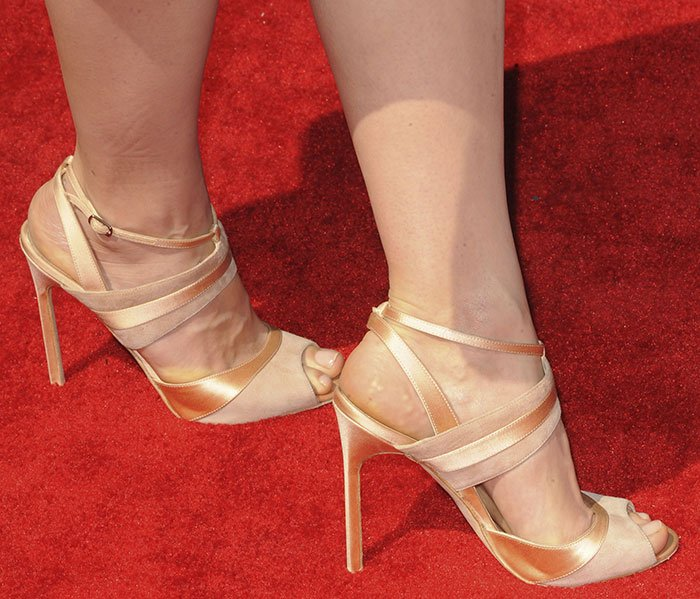Crystal Reed wearing blush sandals by Manolo Blahnik