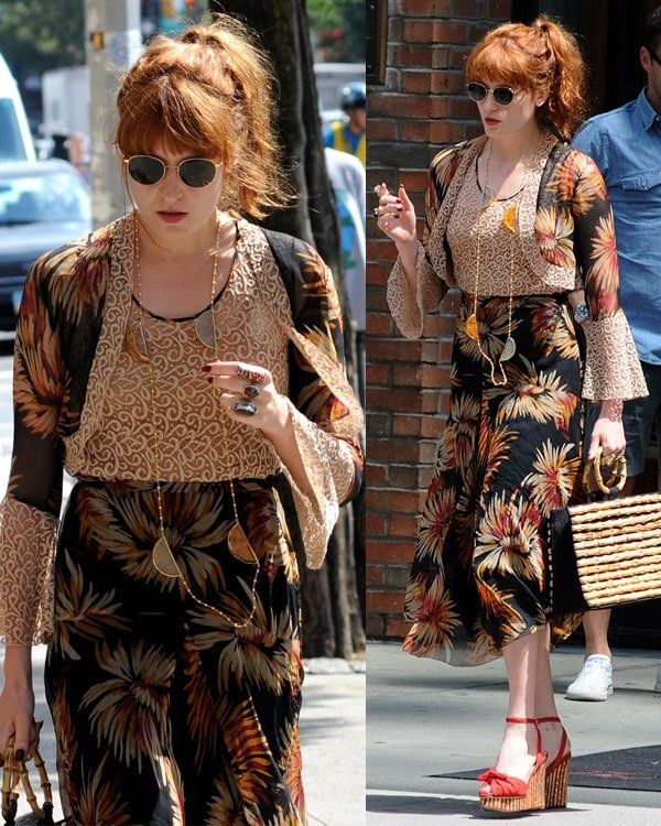 Florence Welch wearinga waist-length necklace and oversized rings in Manhattan on August 2, 2013