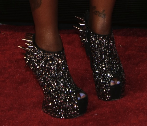Foxy Brown wearing a funky pair of shoes