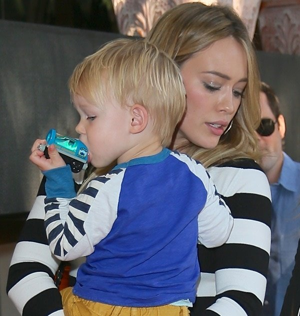 Hilary Duff carries her son Luca Comrie in her arms as she leaves Madeos Restaurant in Los Angeles on October 15, 2013
