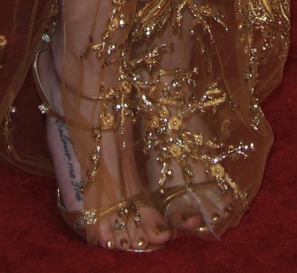 Iggy Azalea wearing gold t-strap sandals