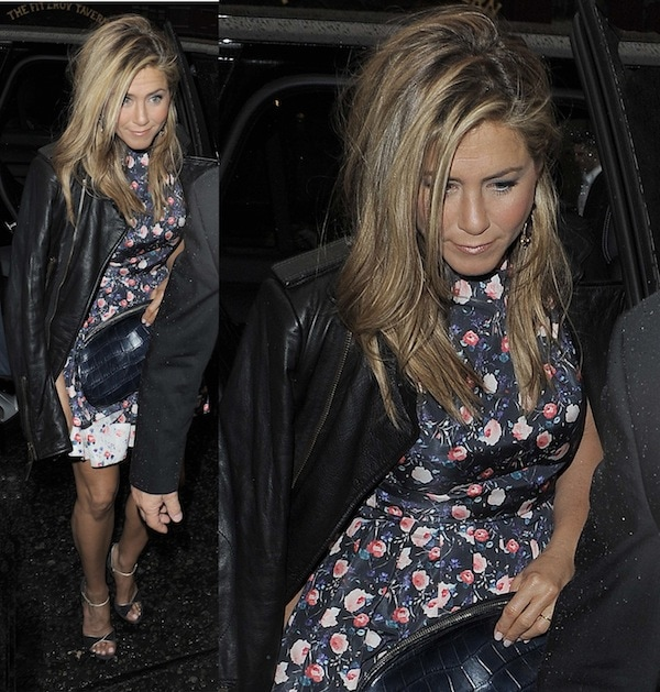 Jennifer Aniston smiled and looked fabulous in a floral-print dress under a black leather jacket