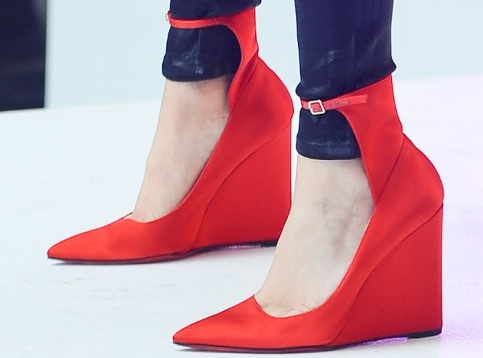 Jessie J wearing satin pointy wedges with ankle straps from Burberry