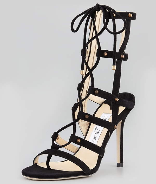 Scintillating architecture dominates a towering suede sandal laced with corset chic