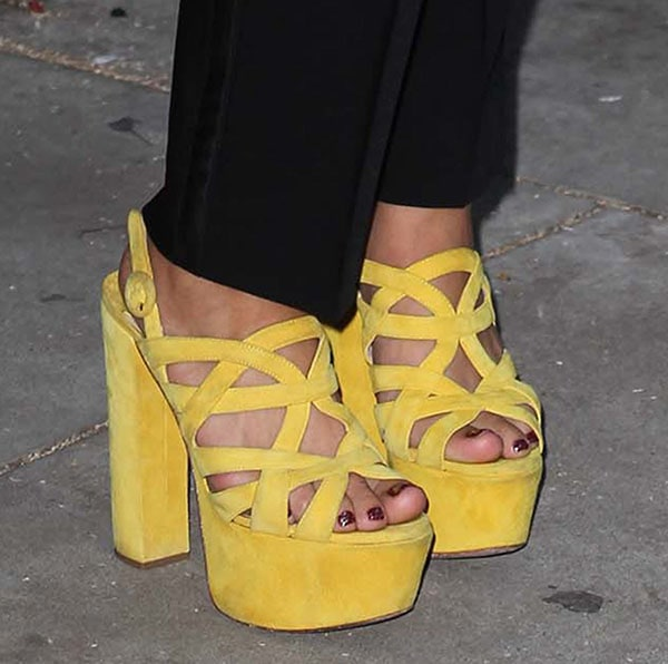 Juno Temple shows off her pretty toes in yellow sandals