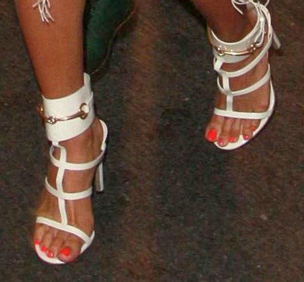 Karrueche Tran wears cage t-strap sandals