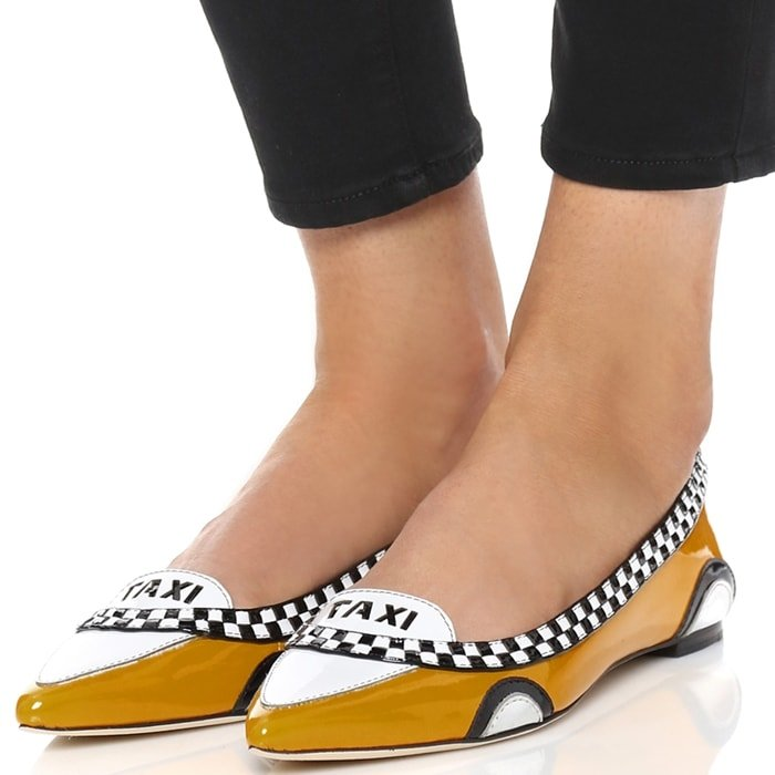 Patent leather forms a playful taxi design on these pointed-toe Kate Spade New York flats