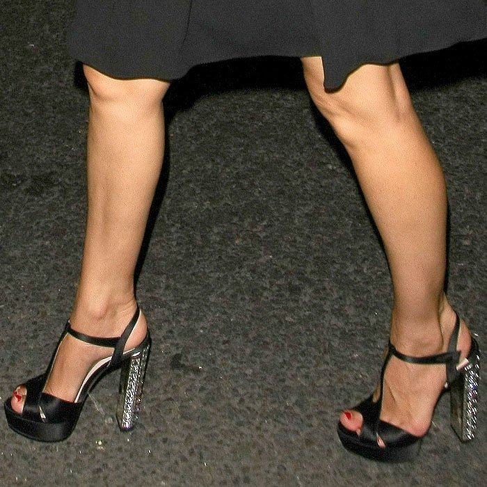 Kelly Brook's pretty feet in jeweled-heel black satin sandals