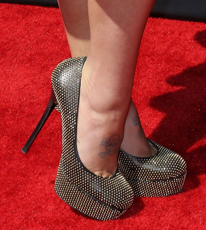 Kelly Osbourne wearing studded Alexander McQueen pumps