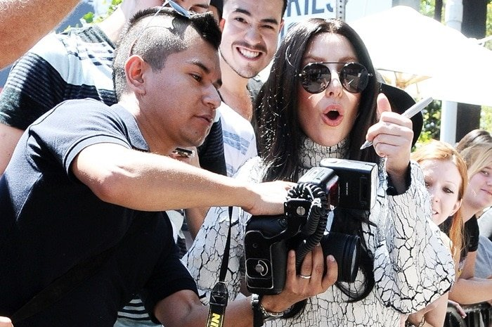 Lady Gaga meeting fans outside Chateau Marmont in Los Angeles on August 17, 2013