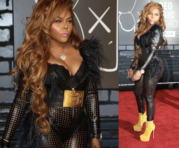 Lil Kim wore what looked like a leather jumpsuit with holes