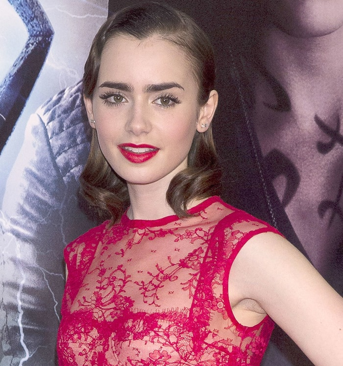 Lily Collins wearing a red lace Houghton frock