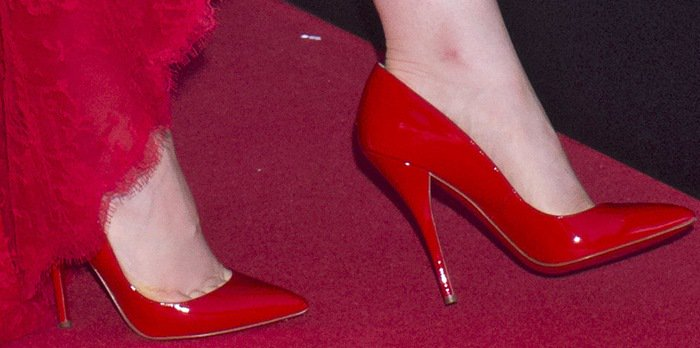 Lily Collins wearing red pumps