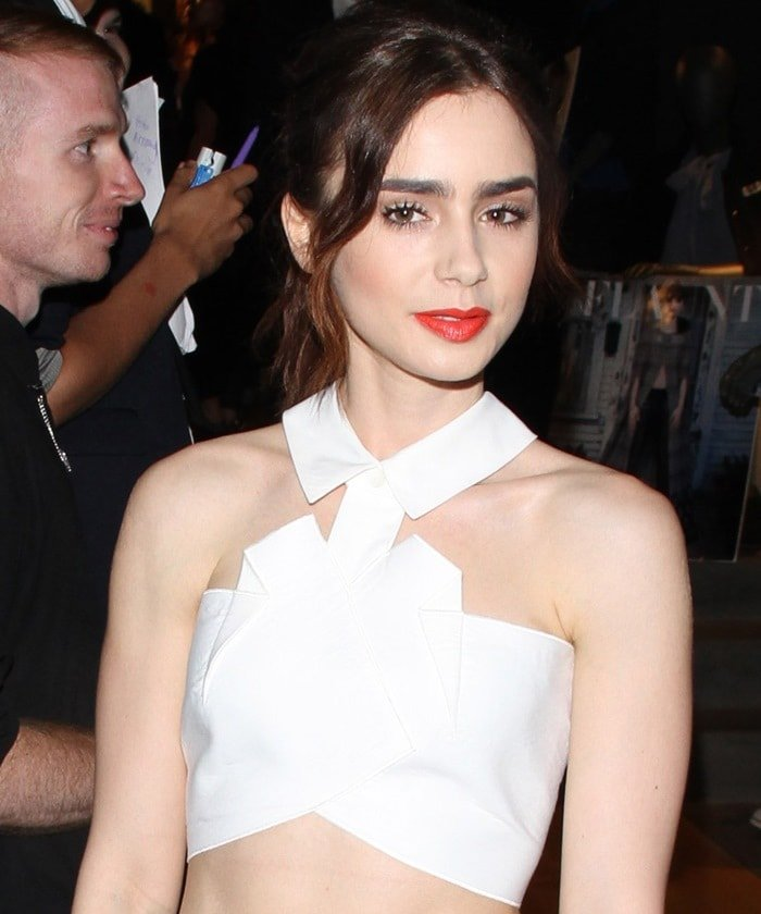 Lily Collins wears a white origami-fied cropped top