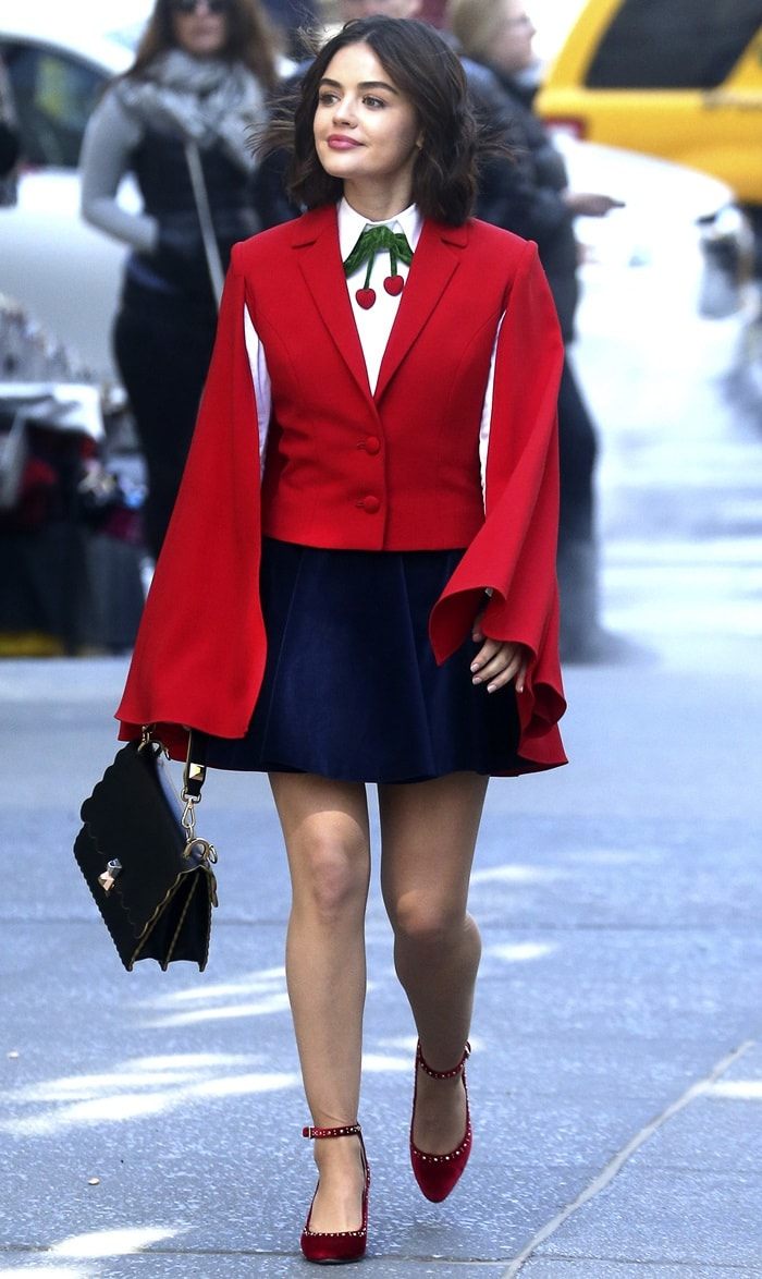 Lucy Hale paraded her legs in a Red Riding Hood-inspired cherry colored cape while shooting new scenes for Katy Keene