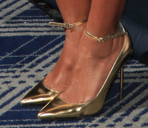 Mel B showed off her sexy feet in mirrored gold patent leather pumps