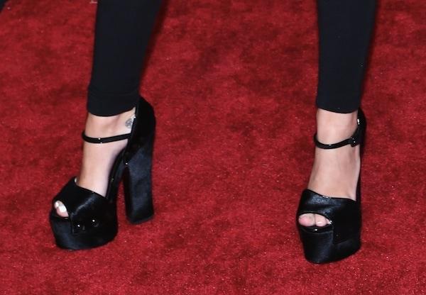 Miley Cyrus causing a stir in Giuseppe Zanotti studded sandals