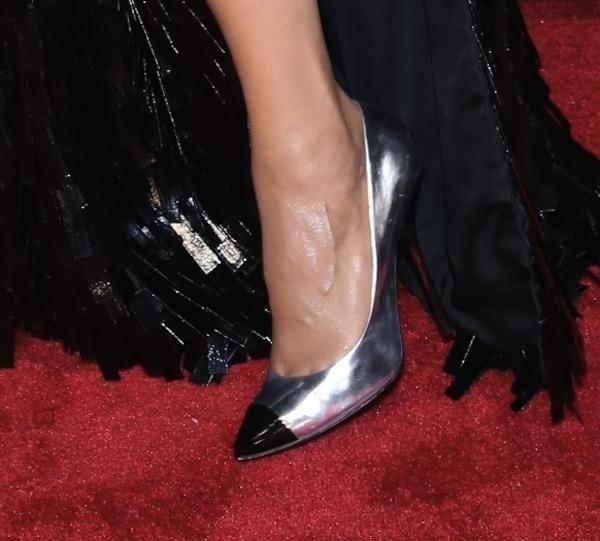 Paula Patton wearing metallic silver cap-toe pumps