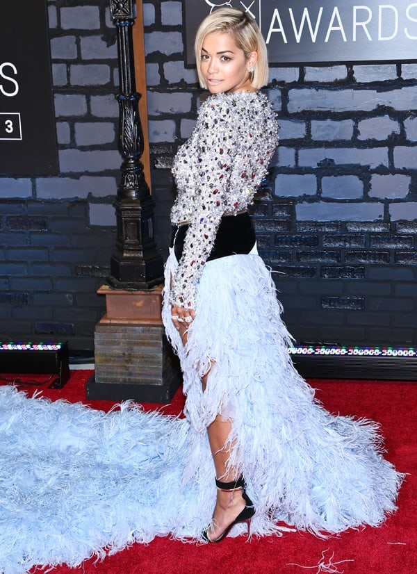 Rita Oraw was very stylish in a blue Alexandre Vauthier couture dress that had a massively long train of feathers