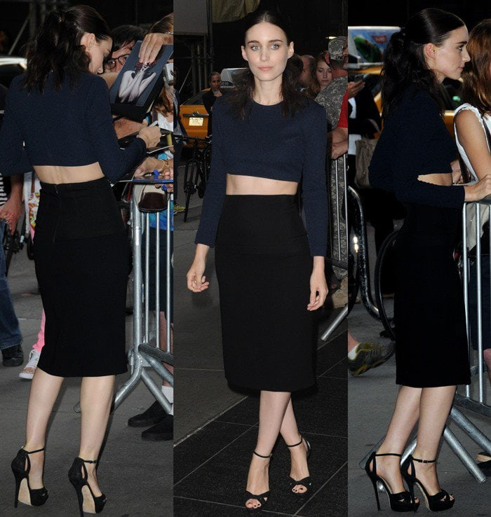 Rooney Mara wears a Calvin Klein navy crop top and a fitted black midi skirt to the premiere of her latest film