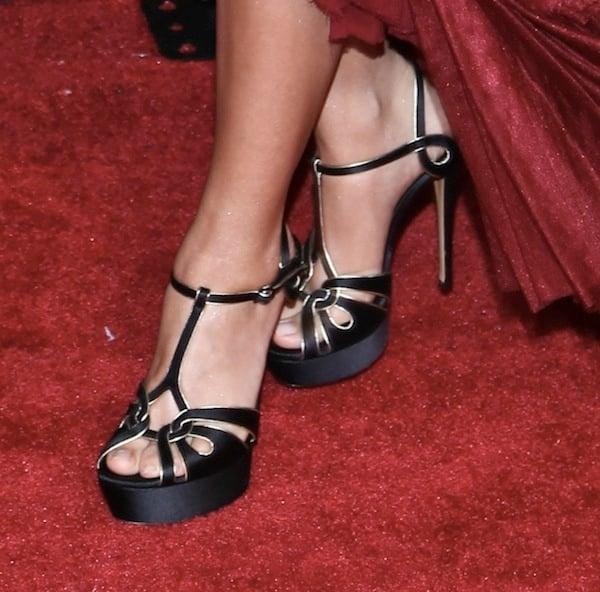 Sarah Hyland wearing strappy black Casadei sandals
