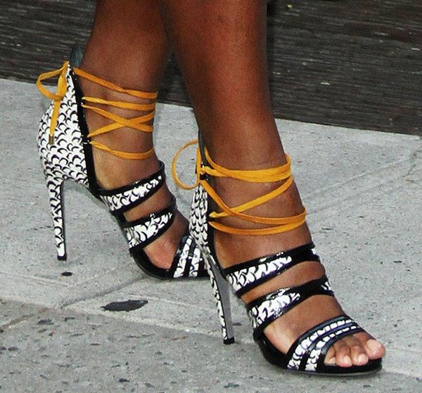 Serena Williams in sandals from Aperlai's Fall 2013 collection featuring artistic print consisting of fish scales on textured snakeskin material