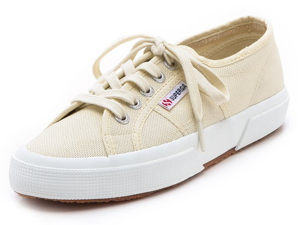 These canvas sneakers feature a logo tag at the lace-up closure.