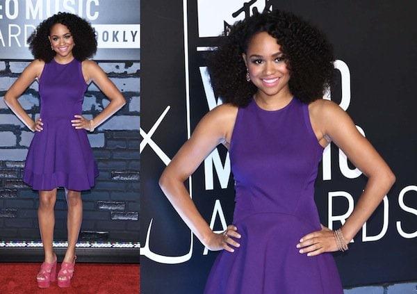 Tanisha Long in a short purple Ted Baker dress