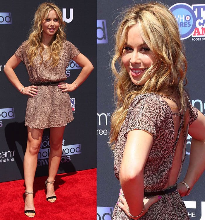 Tara Lipinski wearing a printed mini dress with cutouts at the back