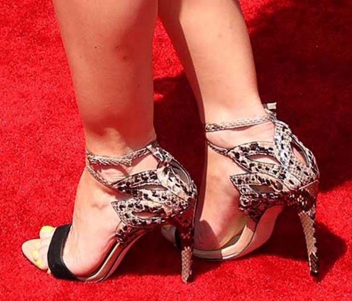 Tara Lipinski wearing snakeskin sandals