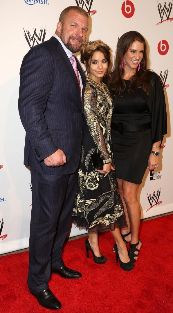 Vanessa Hudgens with Paul Levesque (Triple H) and wife Stephanie McMahon at the WWE charity event