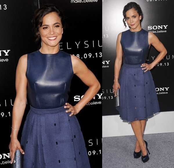 "Cast member Alice Braga poses in a blue Calvin Klein Fall 2013 dress at the world premiere of ""Elysium"""