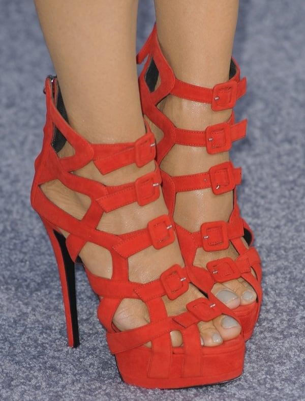 Charlotte Ross in red Giuseppe Zanotti multibuckle sandals