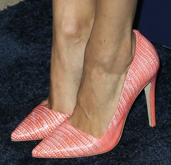 Emmy Rossum's coral pumps with snakeskin effect