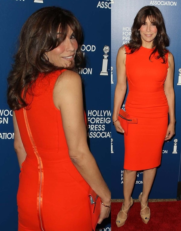 Jo Champa wearing Christian Louboutin with her orange dress as she attends the Hollywood Foreign Press Association Installation Luncheon in Beverly Hills on August 13, 2013