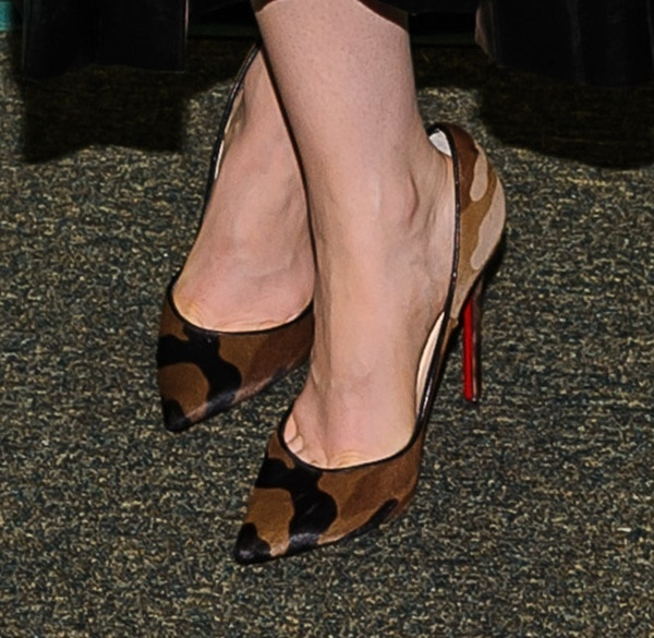 Lily Collins shows off her sexy feet in camo shoes