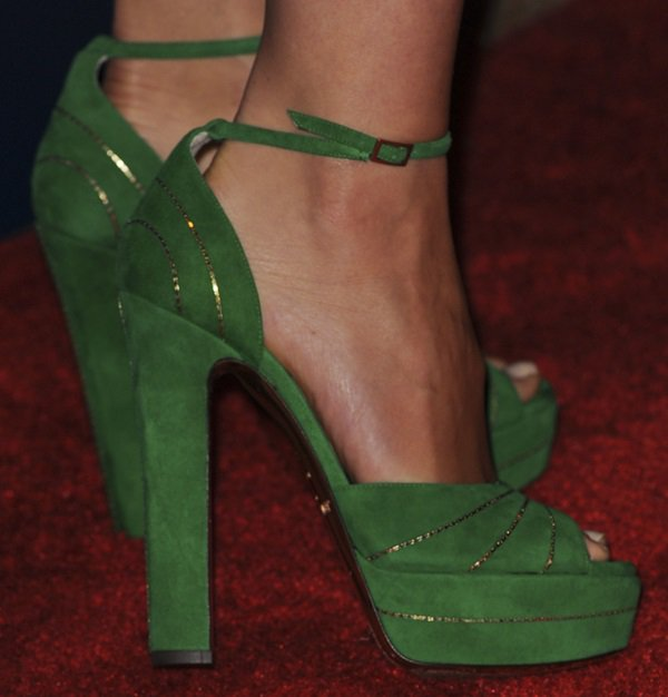 Olivia Wilde wearing green ankle-strap sandals from Jimmy Choo