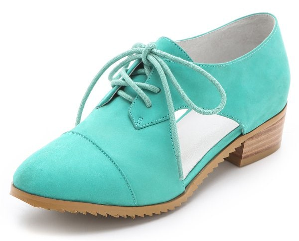 These clever nubuck oxfords are a flattering warm-weather pair, designed with open sides and a low, stacked heel