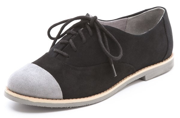 Suede oxfords cut a sleek profile with a tonal lace-up closure and contrasting toe cap