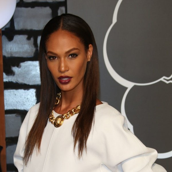 Joan Smalls' chunky gold chain and deep-berry lips