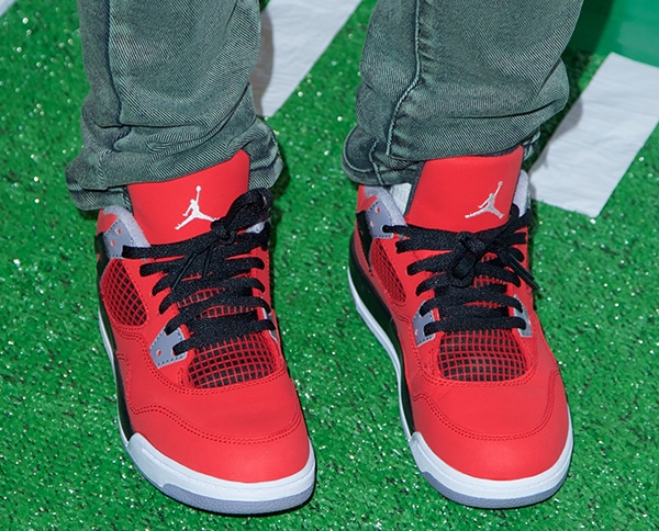 Adrienne Bailon's cool red Jordan sneakers