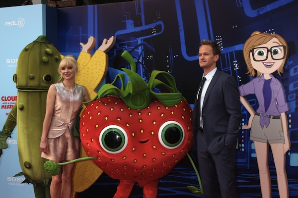'Cloudy with a Chance of Meatballs 2' voice actors Anna Faris and Neil Patrick Harris posing with cartoon cutouts and mascots