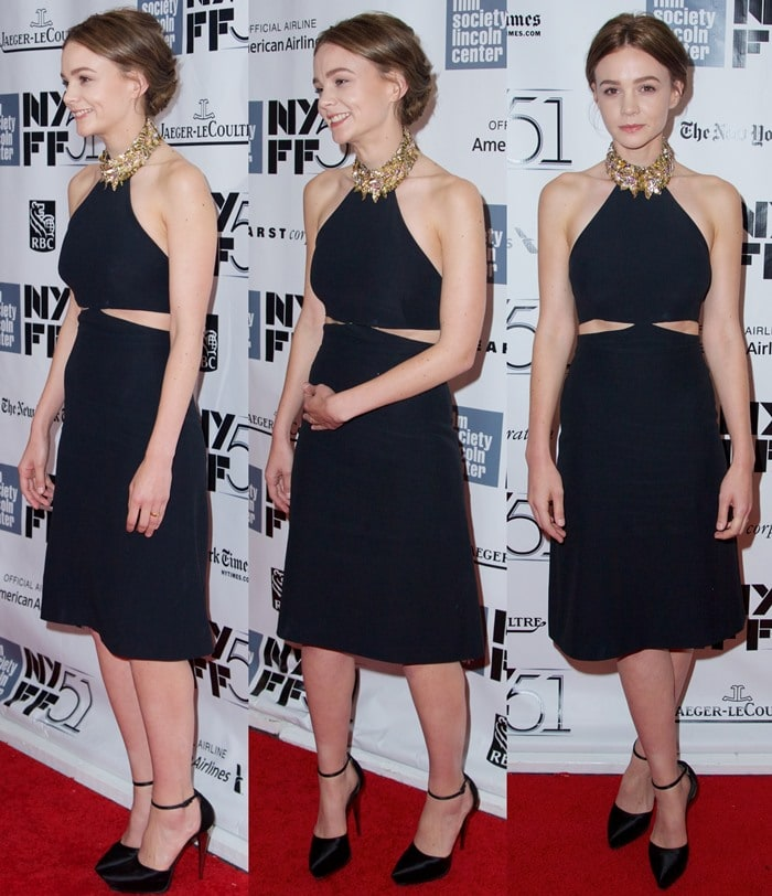 Carey Mulligan poses to show off her Alexander McQueen dress at a New York showing of her new film