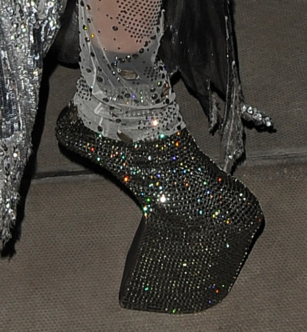 Daphne Guinness shows off her crystal-embellished heel-less shoes